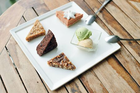 different cakes vegetarian desserts on a white plate