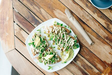 rustic avocado waffles with fresh radish with vegetarian sauce 版權商用圖片