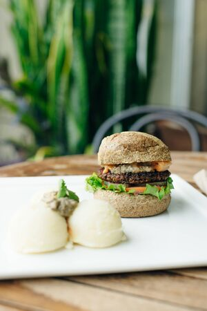 Vegan big bean burger with mashed potato in classic bun 版權商用圖片