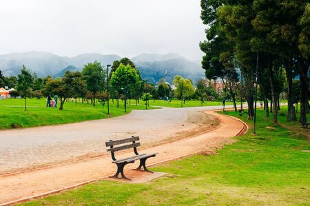 trees and bench in Simon Bolivar Metropolitan public park in the middle of Bogota, Colombia