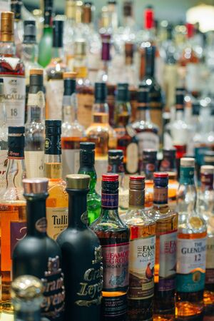 USA - october, 2019 Bottles of alcohol and spirits at a restaurant bar. Large variety of imported and domestic labels, brands . Redakční