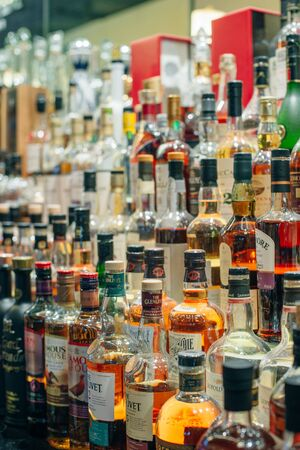 USA - october, 2019 Bottles of alcohol and spirits at a restaurant bar. Large variety of imported and domestic labels, brands . Sajtókép