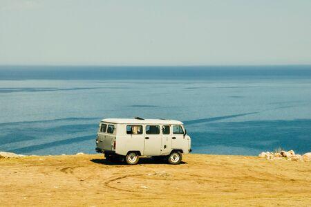 Baikal Lake, Siberia, Russia 2019 Tourist car runing on frozen baikal lake in Russia.