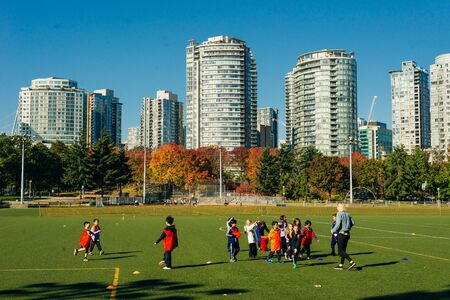 vancouver, canada - september, 2019 football field with kids in downtown.
