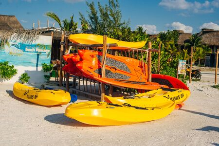 yellow kayaks on the beach in island holbox, mexico.