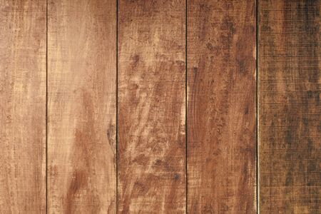 Dark wooden fence. Shabby table, dirty pine lumber. Old wood boards