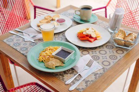 breakfast for two in the hotel with eggs, toast and fruit in mexico
