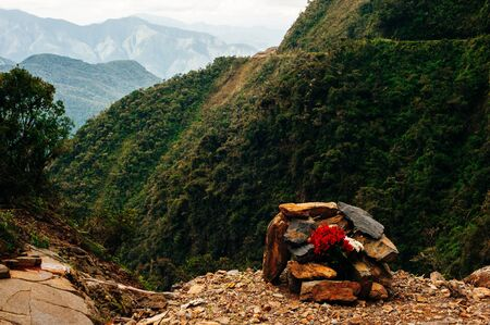 The graves of the dead people participants descent at The Worlds Most Dangerous Death road in Bolivia.