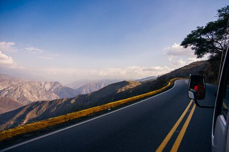 curved road in mountains with cliff.