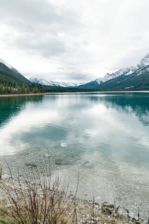Serene sunrise at the Spray Lakes Reservoir is a reservoir in Alberta, Canada Banque d'images