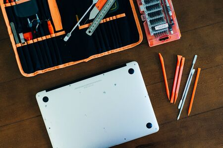 Dismantle laptop with tools and battery, display, hard disk and other components