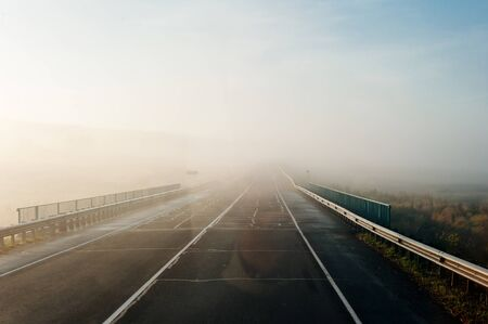 fog on the road in the early morning in Russia. 版權商用圖片