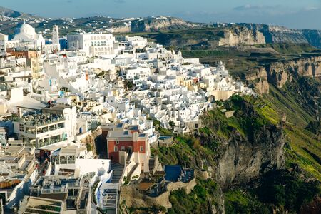 Beautiful view of famous romantic white town in Santorini Island, Greece.