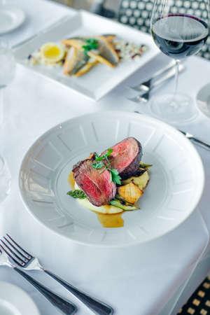 Closeup of a steak with vegetables in a restaurant setting.. Reklamní fotografie - 150619689