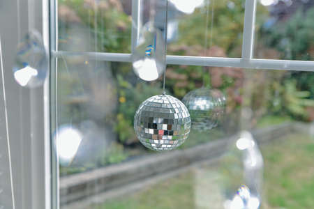 little disco ball sees by the window.