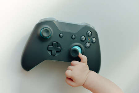 a very small child plays with the joystick