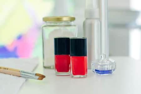 French manicure - preparing tools nail polishes and brushes on white backround top view.