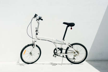white folding bike on a white background.