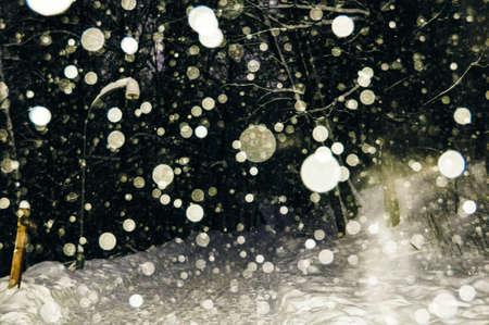 snow flakes at night.