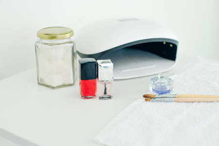 UV lamp. manicure specialist set. Small nail art and manicure business 写真素材