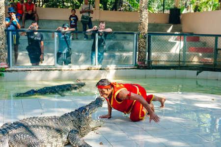 Thailand, Samut Prakan - July, 18, 2016 : Unidentified zoo keeper kiss the crocodile.