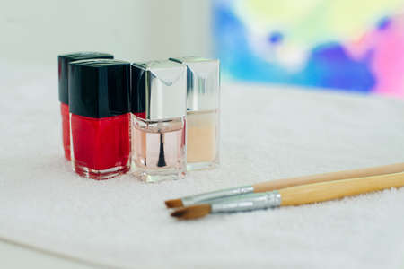 French manicure - preparing tools nail polishes and brushes on white backround top view Banco de Imagens - 151608258
