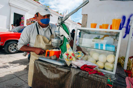 Local street life in the small town. seller of orange juice in mexico, chapas - dec, 2019.