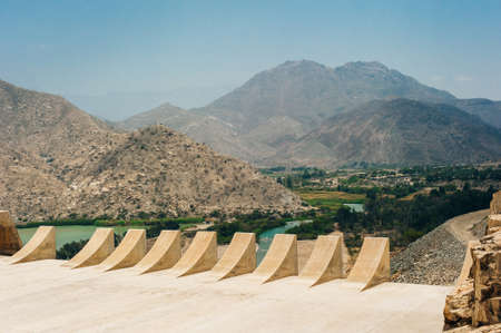 Dam with less water due to drought. Water shortages of water storage dams. Banco de Imagens