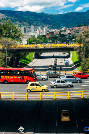 Medellin, Colombia - July, 2019 traffic jam of colorful cars against the background of the city.