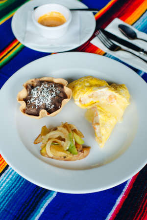 Two delicious indigenous mexican Rolls made with egg omelette with mole and onion Banco de Imagens