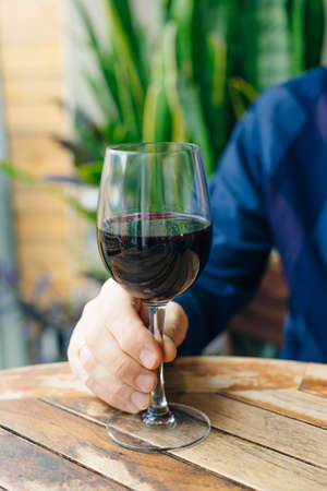 Dry, semi-dry, sweet red wines in special wine glasses on old wooden table