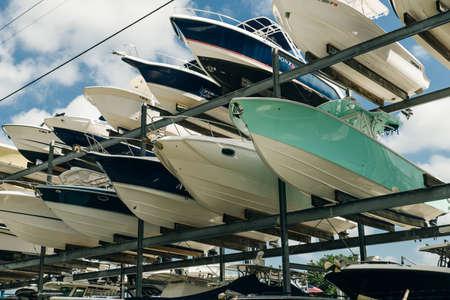 speed motor boats are stapled in a garage system in the prestigious harbor in Miami. Archivio Fotografico