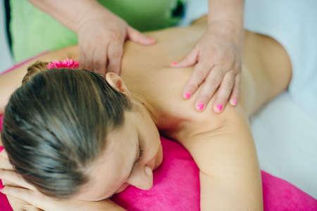 woman masseur doing girl massage in Spa salon close-up