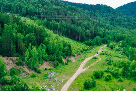 road from above through the forest in russia Banco de Imagens - 151432371
