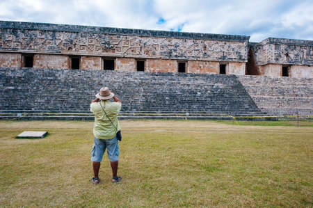 Ancient mayan wall with arches with green garden around in Uxmal, Mexico Banco de Imagens - 151628945