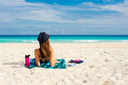 paradise summer vacation happiness carefree happy woman relaxing sitting in sand enjoying tropical beach destination. Stok Fotoğraf