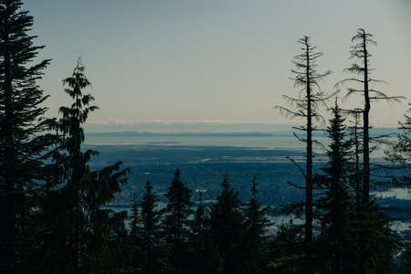 Aerial View of Grouse Mountain with Downtown city. North Vancouver, BC, Canada.