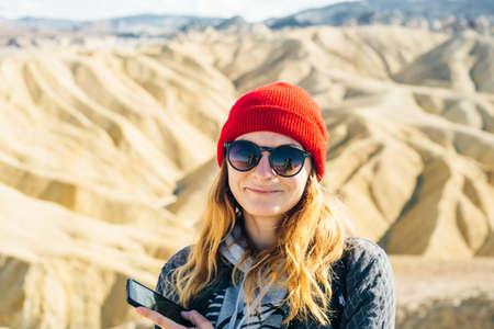 tourist in Zabriskie Point in Death Valley National Park, California, USA