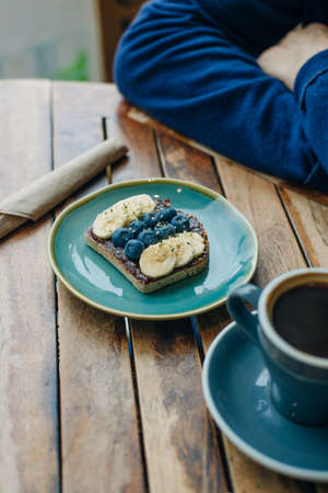 toast with chocolate paste, bananas and blueberries 写真素材