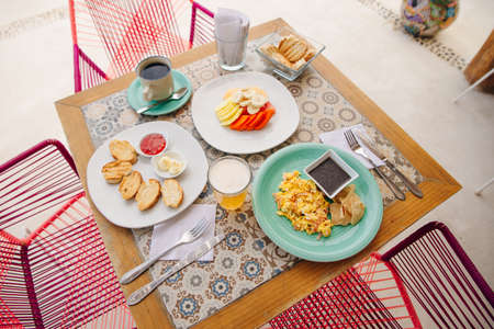 breakfast for two in the hotel with eggs, toast and fruit Banco de Imagens