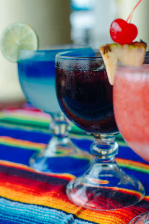 multi-colored cocktails in large glasses Mexico.