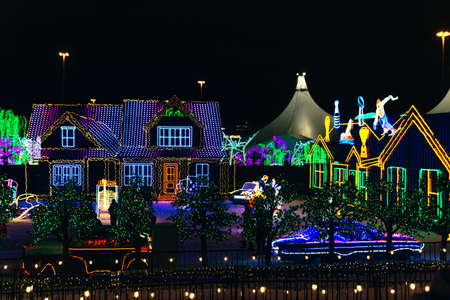 Seasonal Christmas House Lights Decoration, outdoor blurred defocused view. Xmas showcase