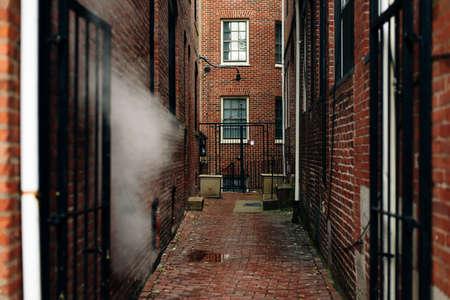 A dark creepy narrow boston alley. boston