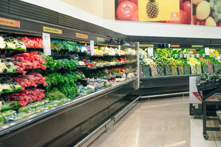 mexico, cancun - junuary , 2020 Big shelf in supermarket with fresh vegetables. 에디토리얼