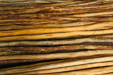 Dark wooden fence of twigs stick texture. Wooden background of pines for design Reklamní fotografie