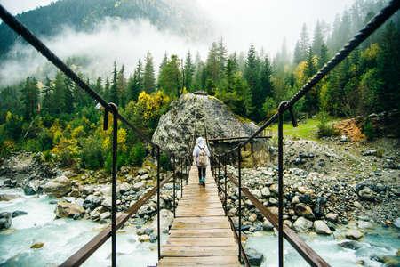 Svaneti region, Georgia, Caucasus - bridge over a mountain river. 스톡 콘텐츠