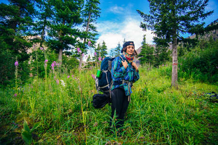 portrait girl traveler with a backpack forest