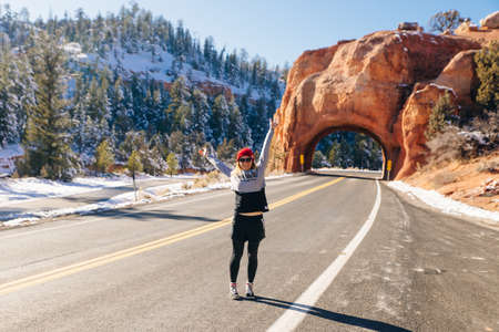 girl on the background Red Arch road tunnel on the way to Bryce Canyon National Park,Utah,USA