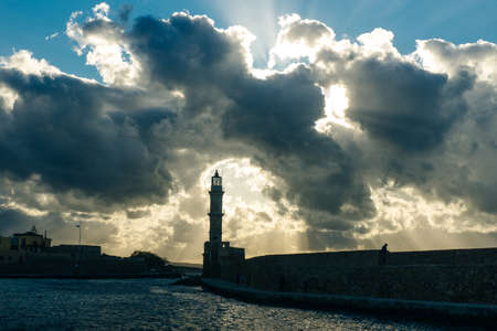Venetian harbour and lighthouse in old harbour of Chania, Crete, Greece - sep, 2019. Banco de Imagens - 151332118