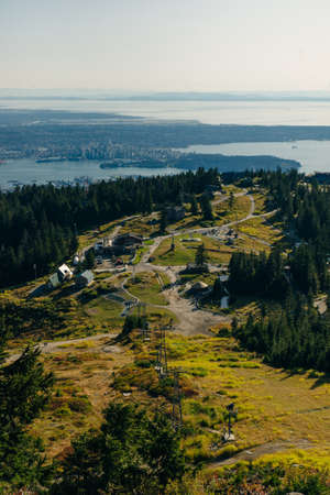 Aerial View of Grouse Mountain with Downtown city. North Vancouver, BC, Canada